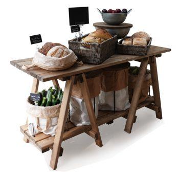 Trestle-Table-finishing-touches-breads-with-sacks-on-base-shelf