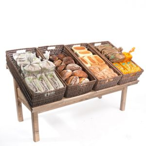Sloping-Table-with-large-wicker-baskets-bakery-display