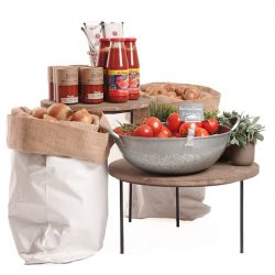 Merchandising-risers-with-white-sacks-Tomatoes-and-onions