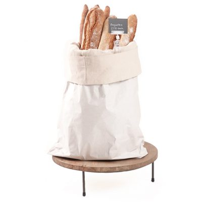 White-sack-with-cotton-lining-on-low-merchandising-riser-Bread-stand